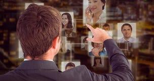 Image composée d'homme d'affaires se dirigeant avec son doigt photos libres de droits