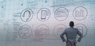 Image composée d'homme d'affaires se tenant avec des mains sur des hanches Photos libres de droits