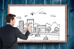 Image composée d'homme d'affaires se tenant de nouveau à l'écriture d'appareil-photo avec le marqueur Images stock