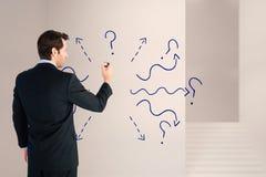 Image composée d'homme d'affaires se tenant de nouveau à l'écriture d'appareil-photo avec le marqueur Image libre de droits