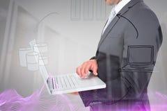 Image composée d'homme d'affaires tenant l'ordinateur portable photos stock