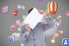 Image composée d'homme d'affaires tenant le signe vide devant sa tête Photographie stock