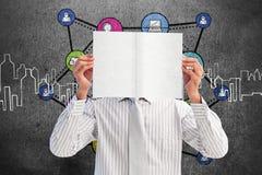 Image composée d'homme d'affaires tenant une carte blanche couvrant son visage Images stock
