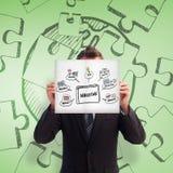 Image composée d'homme d'affaires tenant une carte blanche devant son visage Photographie stock libre de droits