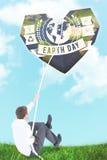 Image composée d'homme d'affaires tirant une corde avec l'effort photographie stock libre de droits