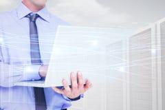 Image composée d'homme d'affaires utilisant un ordinateur portable photographie stock libre de droits