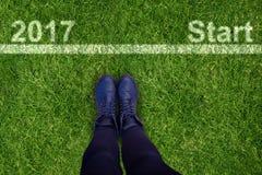 Image composée d'image cultivée des chaussures de port de personne Photographie stock libre de droits
