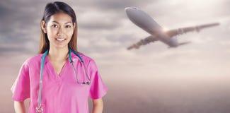 Image composée d'infirmière asiatique avec le stéthoscope regardant l'appareil-photo photo stock
