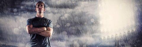 Image composée d'intégral du joueur sûr de rugby avec des bras croisés Photos libres de droits
