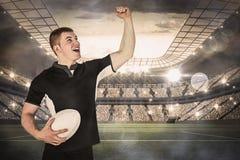 Image composée d'un joueur de rugby faisant des gestes la victoire Photographie stock
