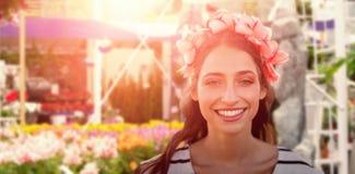 Image composée de belle femme de sourire avec une couronne de fleur Images stock