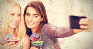 Image composée de belles femmes prenant le selfie avec le téléphone portable photo stock