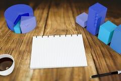 Image composée de bloc-notes avec des graphiques Photographie stock