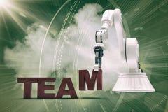 Image composée de bras robotique s'chargeant du texte 3d d'équipe Photographie stock libre de droits