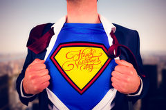 Image composée de chemise d'ouverture d'homme d'affaires dans le style de super héros Photos libres de droits