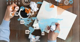 Image composée de Digital d'homme d'affaires avec du café et les papiers chiffonnés au bureau Image libre de droits