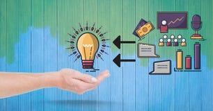 Image composée de Digital de main protégeant l'ampoule par des icônes d'affaires Photographie stock