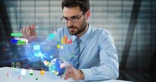 Image composée de Digital des icônes émouvantes d'homme d'affaires au bureau Image stock