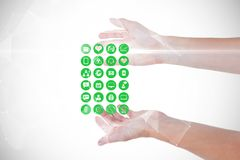 Image composée de Digital des mains avec de diverses icônes médicales Image libre de droits