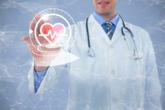 Image composée de docteur touchant un écran numérique Photo stock