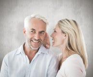 Image composée de femme chuchotant un secret au mari Images libres de droits