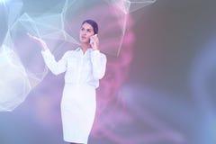 Image composée de femme d'affaires au téléphone photos libres de droits