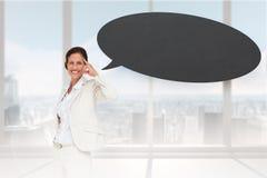 Image composée de femme d'affaires de pensée avec la bulle de la parole Image stock