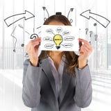 Image composée de femme d'affaires montrant une carte Image libre de droits