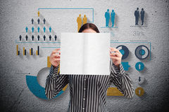 Image composée de femme d'affaires montrant une carte blanche devant son visage Images libres de droits