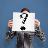 Image composée de femme d'affaires montrant une carte blanche devant son visage Images stock