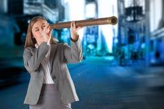 Image composée de femme d'affaires regardant par un télescope Photo libre de droits