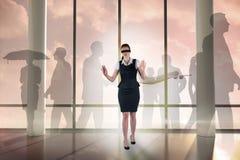 Image composée de femme d'affaires rousse dans un bandeau Photos stock