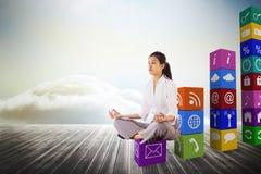 Image composée de femme d'affaires se reposant dans la pose de lotus photo stock