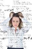 Image composée de femme d'affaires soumise à une contrainte avec des mains sur sa tête Image libre de droits