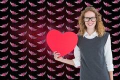 Image composée de femme de ballot tenant le coeur rouge Photographie stock libre de droits