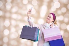 Image composée de femme de sourire avec des paniers prenant des selfies photo libre de droits