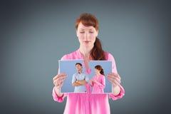 Image composée de femme discutant avec l'homme insensible Photographie stock