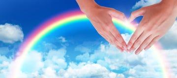 Image composée de femme faisant la forme de coeur avec des mains Photo libre de droits