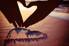 Image composée de femme faisant la forme de coeur avec des mains Photographie stock libre de droits