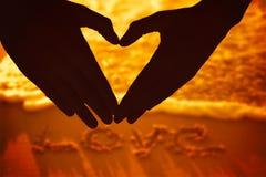Image composée de femme faisant la forme de coeur avec des mains Photos stock