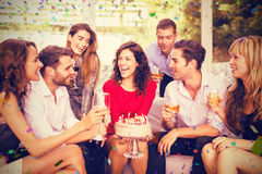 Image composée de femme gaie célébrant son anniversaire avec des amis Images libres de droits