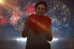 Image composée de femme tenant la carte de coeur Images libres de droits
