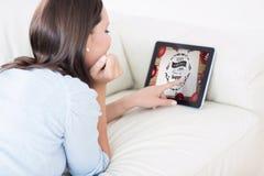 Image composée de femme touchant son comprimé numérique photos stock
