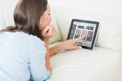 Image composée de femme touchant son comprimé numérique photo stock