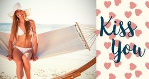 Image composée de fille sur des mots de plage et de valentines Image libre de droits