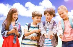 Image composée de garçon avec des amis à l'aide du téléphone portable Photographie stock libre de droits