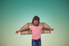 Image composée de garçon de sourire feignant pour être pilote Photos libres de droits