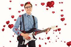 Image composée de hippie geeky jouant la guitare Photo libre de droits