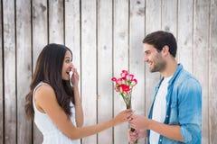 Image composée de hippie heureux donnant à son amie des roses Photos stock