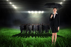 Image composée de jeune femme d'affaires tenant le parapluie Images libres de droits